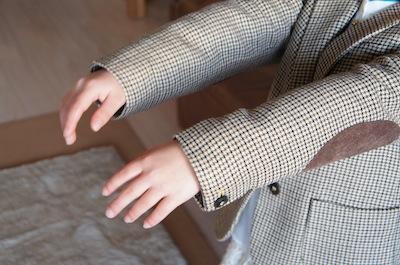 ジャケットの袖長さ調整